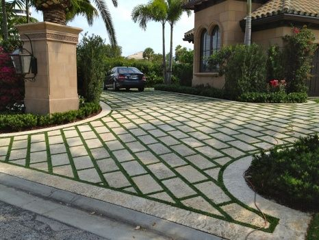Driveway in Florida home with grass paver strips!