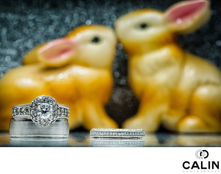 Photography by Calin - LIBERTY GRAND WEDDING Photography:  This is a creative photograph of the wedding rings captured during a Liberty Grand wedding. ,  A good Toronto wedding photographer has to master quite a few aspects of photography. During the bride preparation, wedding details are extremely important in the photographer has to capture images of the rings, shoes, dress, earrings, garter, bouquet, any family heirlooms such as medallions, necklaces, bracelets and many many more. The...