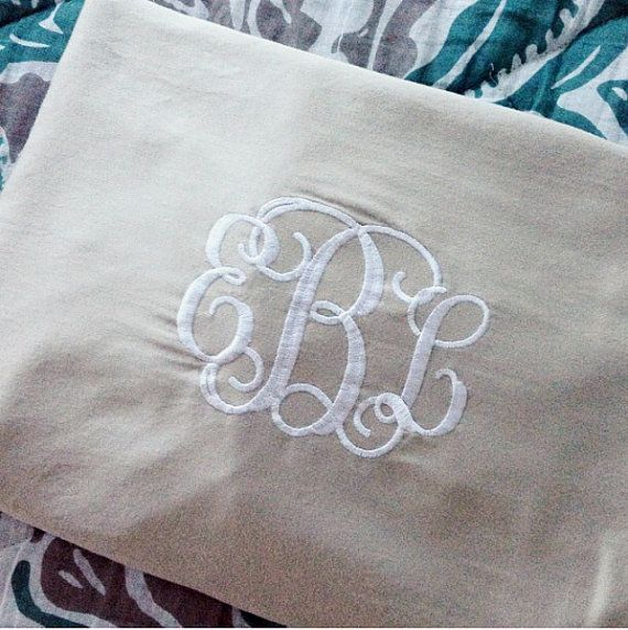 Set of two standard-size pillow covers with an embroidered monogram of your choice (you have the option of 3 initials, single letter, or two
