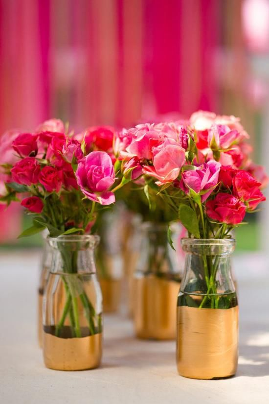 I love the handpainted gold vases with the bright pink flowers. Cute DIY wedding project!