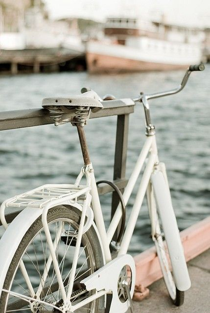 Parking your bike on the pier while watching boats sail in and out of the bay