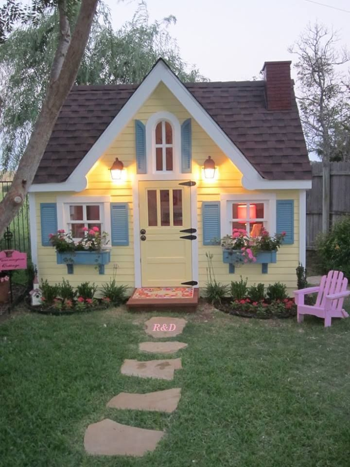 Yellow Cottage House with Blue Shutters and windowboxes