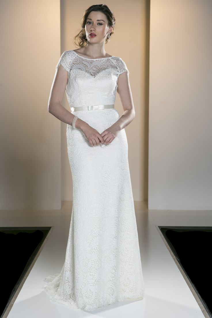 OCA 566T 'Naomi' A vintage inspired full length gown with a boat neck and cap sleeves in a soft Guipure lace.