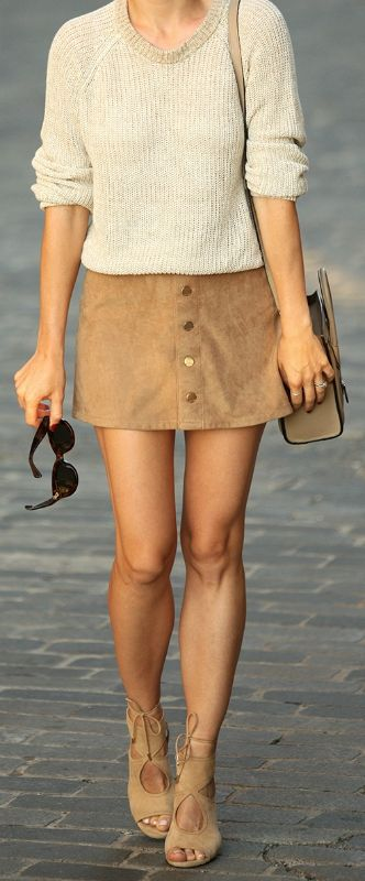As Fall approaches keep your suede skirt outfits in neutral colours. Pair it with a knit sweater and suede sandals. Via Helena Glazer Skirt: Express, Sweater: Theory, Shoes: Aquazzura, Bag: Celine