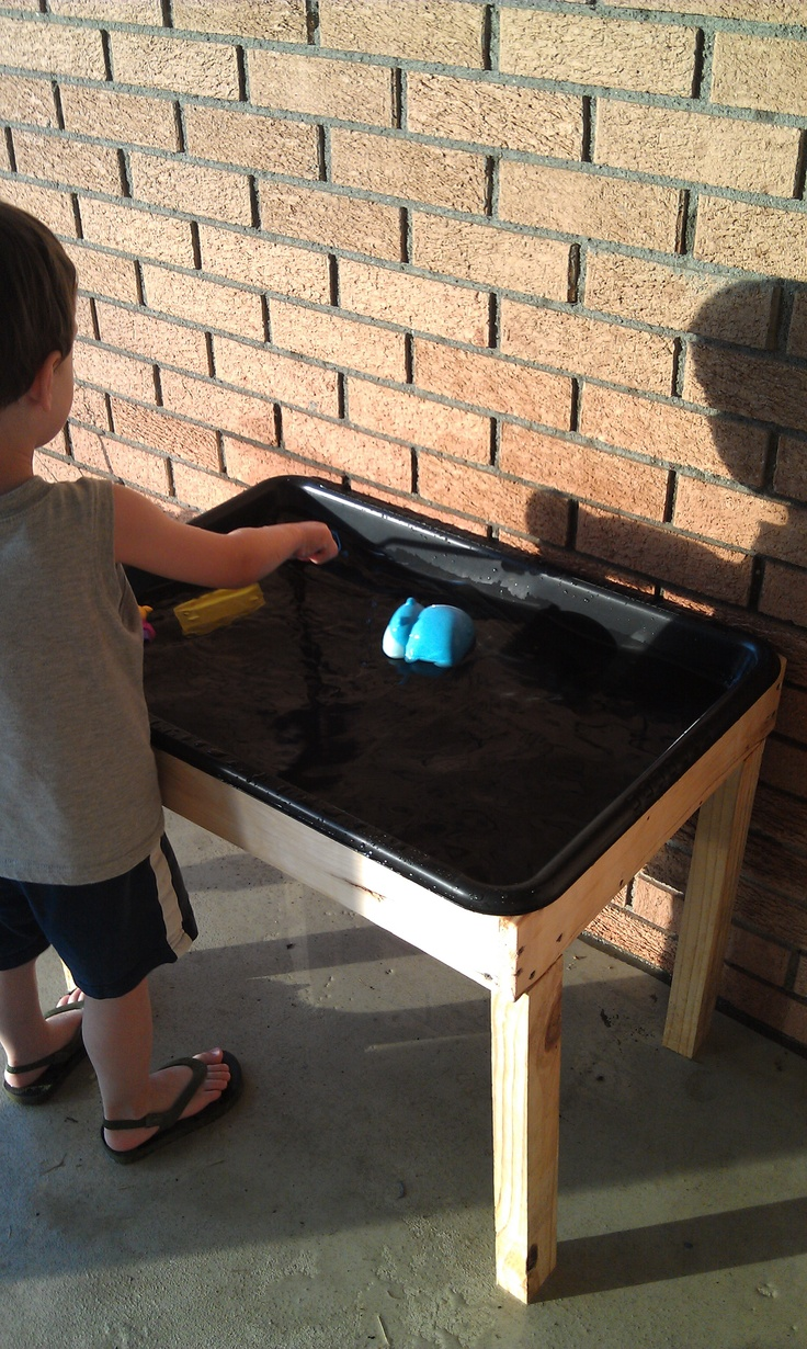 Homemade water table.  Cost: $7!  Used scrap lumber and bought cement mixing tub at Home Depot!