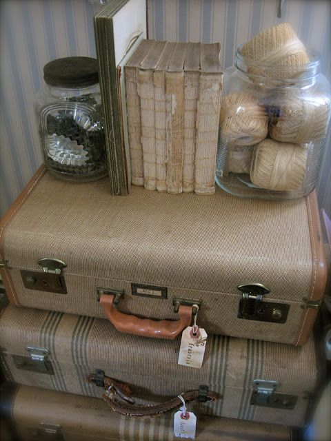 Vintage Suitcases Used For Storage - simply add tags to label what is inside. This is a great way to organize your craft room or office & they're easy to find at flea markets.