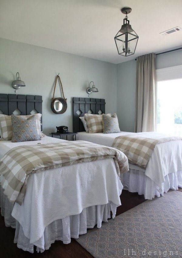 Country guest room with rustic wood head boards on twin beds