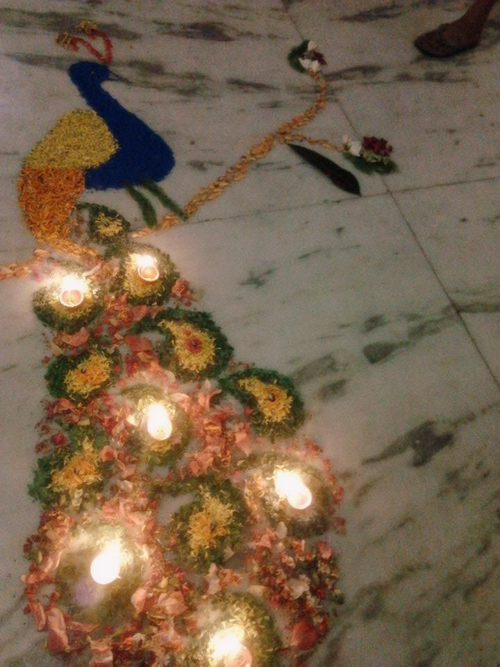 Peacock rangoli  design by using flowers petals!! <3