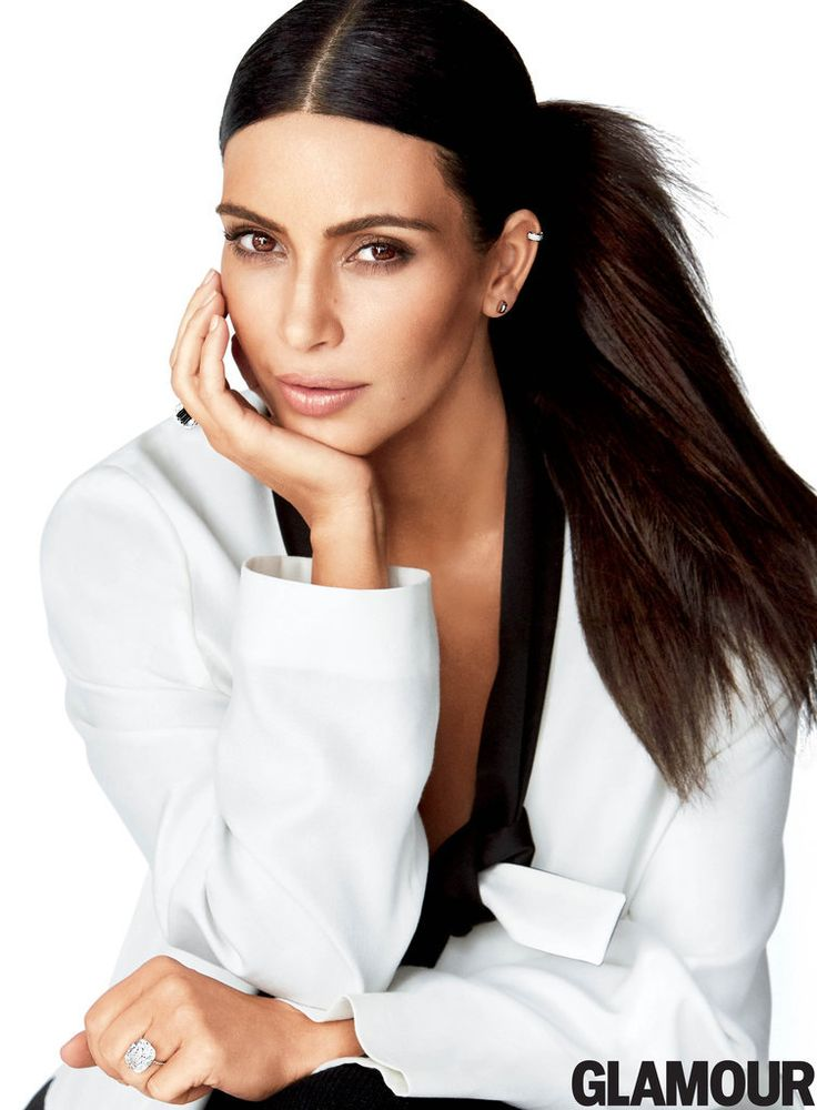 Kim Kardashian wearing a MM6 Maison Margiela jacket and pants, Eva Fehren ear cuff, and Melissa Kaye Jewelry earrings on the cover of Glamour Magazine.