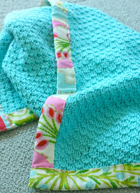 Add hand-sewn blanket edging - nice out-of-the-ordinary touch, very pretty on a solid color.