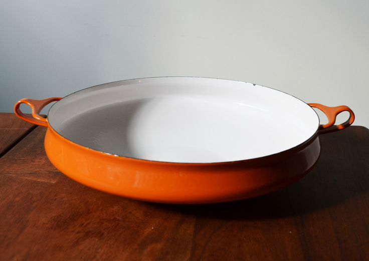 Mid Century Dansk Kobenstyle Enameled Steel Cookware, Large Orange Paella Pan or Buffet Bowl, Jens Quisgaard design 1970s by Trashtiques on Etsy https://www.etsy.com/ca/listing/453680624/mid-century-dansk-kobenstyle-enameled