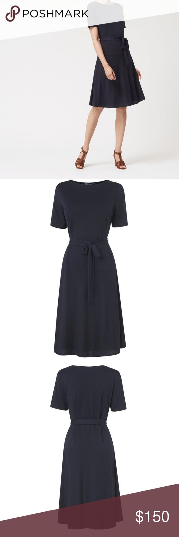 L.K. Bennett Evelyn Dress- Navy T shirt dress The T-shirt dress has never looked so chic. This off-duty style is cut from a soft cotton-blend and playfully flares at the hem. Use the waist-tie to define the silhouette, and style with bare legs and sandals for the perfect vacation-ready look.  Fabric Composition: Main: 68% Lyocell, 32% Cotton Lining: 100% Viscose  UK 10/ US 6  Smoke free home NO TRADES---REASONABLE OFFERS WELCOME LK Bennett Dresses