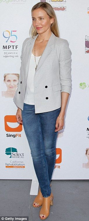 Laid-back chic: The 43-year-old actress dressed her lean legs in a pair of denim skinny je...