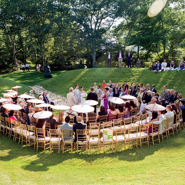 Love how this horseshoe-shaped seating arrangement creates a more intimate wedding ceremony.