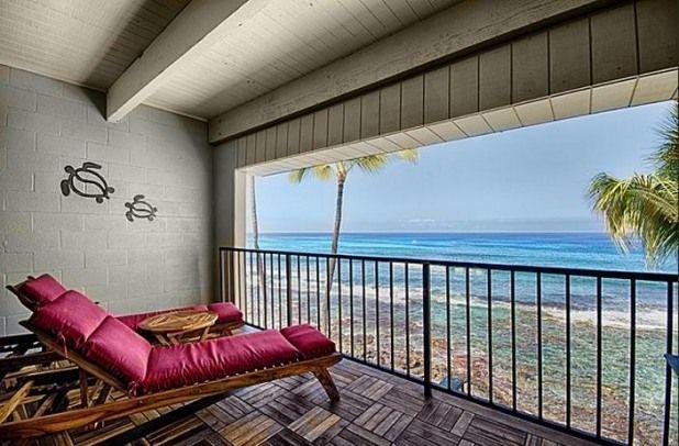 Dual loungers on the teak and ironwood lanai with the ocean crashing below
