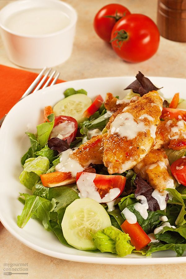 Shallow-fried chicken tenderloins bathed in melted butter and sweet Thai chili sauce and a tangy blue cheese ranch dressing turn a simple salad into a delicious and satisfying main dish.