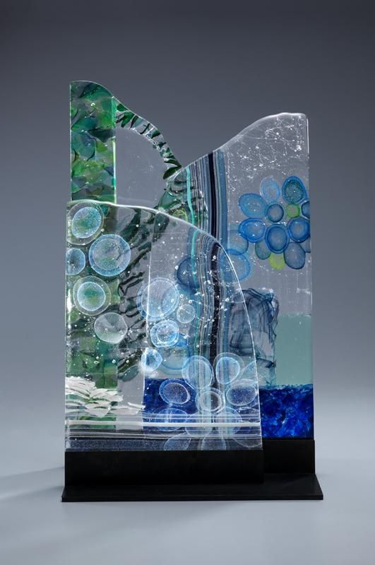 "AKIKO IWASE AKIKO IWASE Entry 2/88Previous Next AKIKO IWASE ""Story of Timberline"" I've got inspirations from the lights, flow, and so on while i am trekking. 3 pieces of glass plates makes visual effects and these pieces have own patterns in the glass. sodaglass Unspecified kiln"