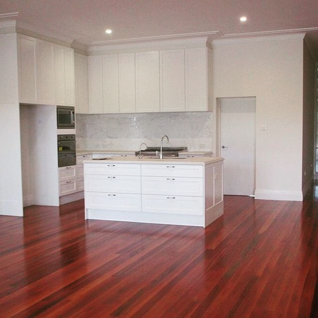 Beautiful custom made kitchen with Caesarstone benchtop is nearly complete for our North Shore extension project and looks amazing against the Red Mahogany floors. #kitchen #custommade #localbuilder #extension #redmahogany #flooring #white #northshore  #sydneybuilder #sydney #caesarstone #cabinetry #builder www.buildingworksaust.com.au @buildingworksau #newsbuildingworksaust