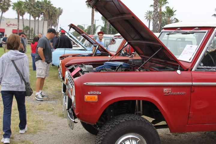 Red  Ford Bronco early Ford small SUV on display hood up