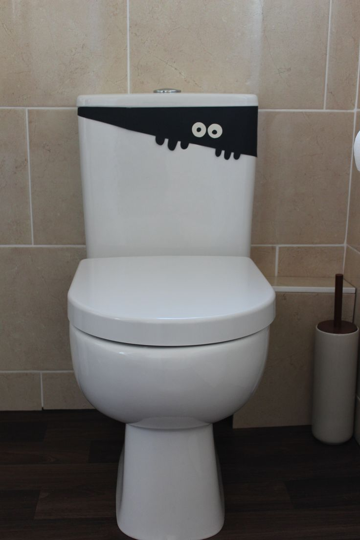 Toddler friendly Halloween party decorations.  Black paper craft ghost hiding in the toilet!