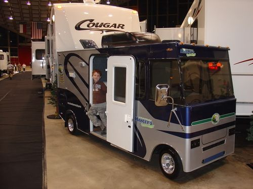 For those of us that cant afford a full size motorhome, perhaps a RV golf cart is a better buy. This is a must see addition that would turn heads for sure.