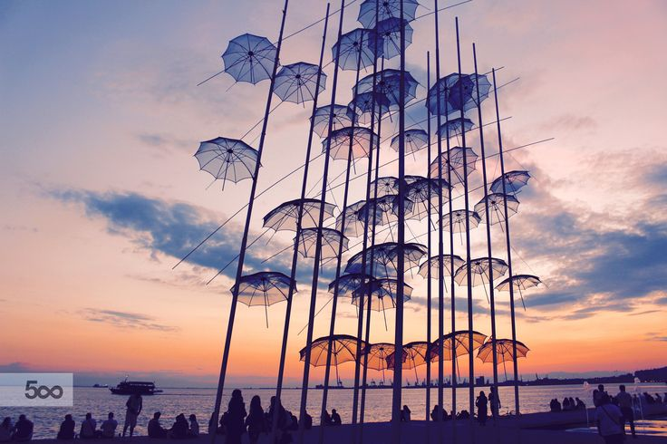 Umbrellas sculpture at the waterfront of Thessaloniki, Greece. The sculpture was created by the world famous greek artist George Zongolopoulos, placed in Thessaloniki in 1997 when the city was the European Capital of Culture.