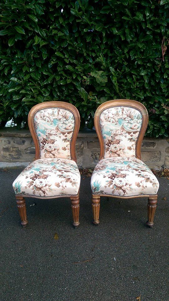 A pair of newly upholstered Edwardian oak spoon back salon chairs