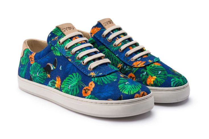 The SYOU CO.5 TOUCAN & FLOWERS Sneaker with bold floral canvas upper and blue stitching. Leather trims on tongue and heel patch. Get yours at SYOU.com