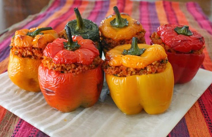 These colorful roasted peppers are stuffed with a hearty filling of nutty bulgur wheat and tomatoes, seasoned with onion, parsley and cilantro, perfect as a side dish or main course.