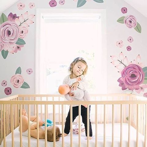 Can we talk about that floral nursery wall?