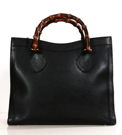 Balck bag. Dark bamboo-like handles