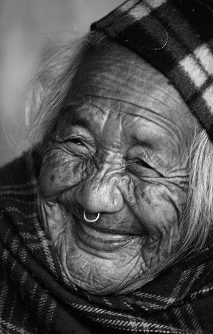 I love portraits. Especially ones of old people with lots of wrinkles. So many memories contained in those lines...