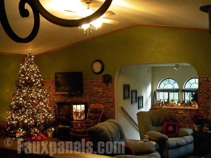 Stacked stone faux siding partially covers a wall, creating an accent area and beautiful backdrop for this family's Christmas tree.   http://www.fauxpanels.com/img_c/10-norwich/design/055.jpg