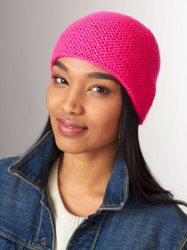 This simple garter stitch hat is perfect for adding a pop of color to any look, and makes a great project for beginner knitters. #brights #neon #hotpink