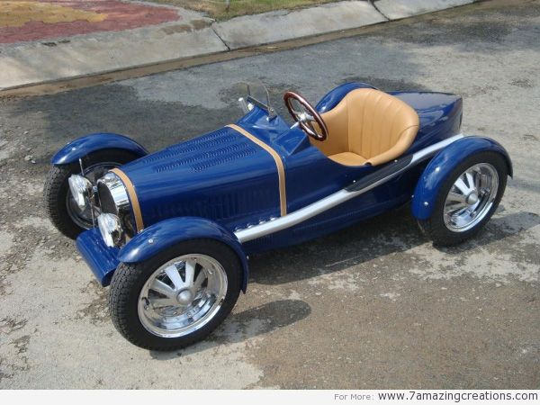 """The """"Children's cars"""" are manufactured by the Harrington Group. These half-scale replicas of classic cars, like the Jaguar E-Type and Mercedes Benz, can function quite well. They can be customed and upgraded."""