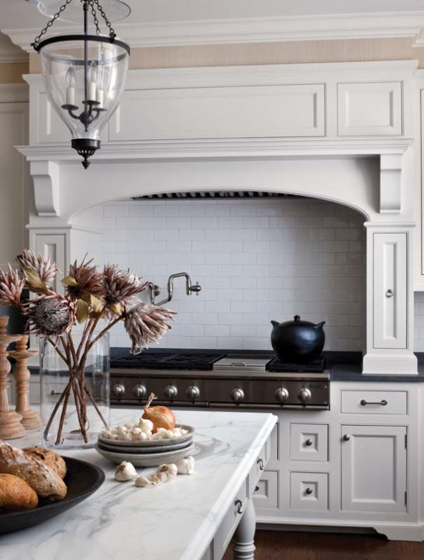 white subway tile + marble + pendant in classic white kitchen by Boxwood Home Design
