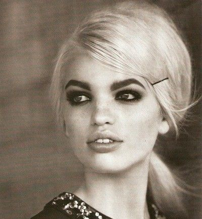 Side pinned pony with 60's eyes and brows. Perfect