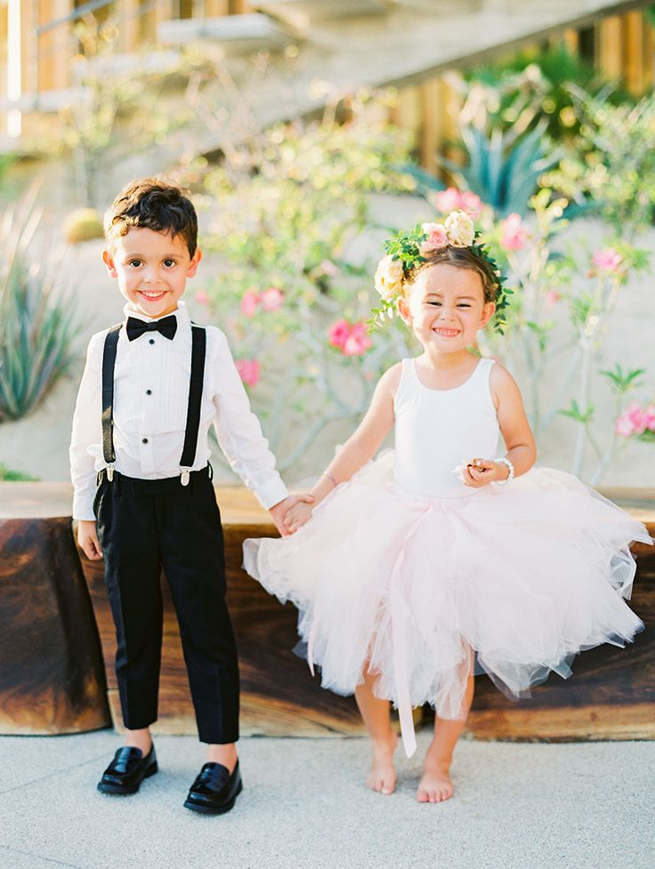 Smile big, smile often like this flower girl and ring bearer! Photography: Sally Pinera - sallypinera.com   Read More on SMP: http://www.stylemepretty.com/2017/02/23//