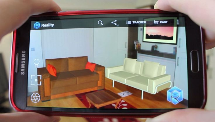 A living room with virtual sofas, a virtual coffee table and picture