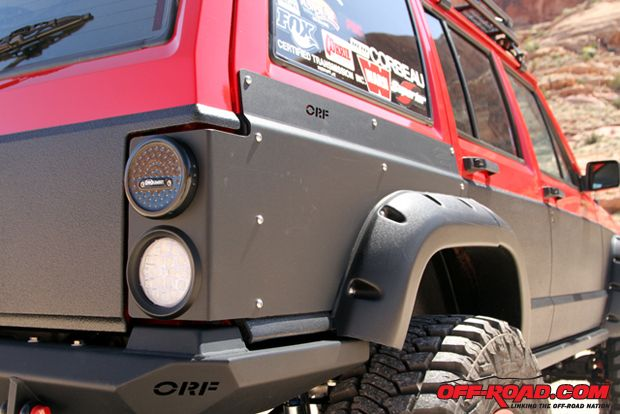 XJ rear quarter body armor is already available from OR-Fab and Faustmann added LED lights to give the vehicle a customized appearance.