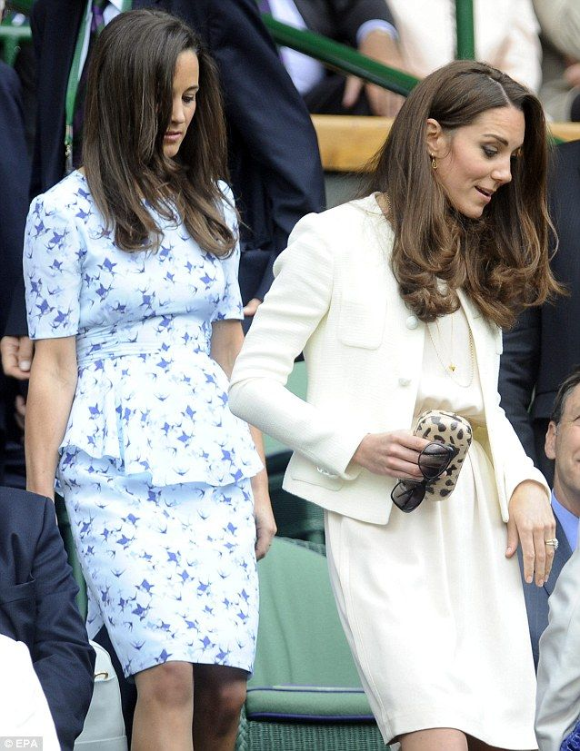 Clutching a leopard skin bag and sunglasses Kate heads to her seat followed by Pippa for the final Wimbledon match. July 8, 2012