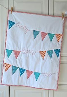 a quilt from mamas kram (in german) I am thinking putting bunting into a baby quilt design might be fun