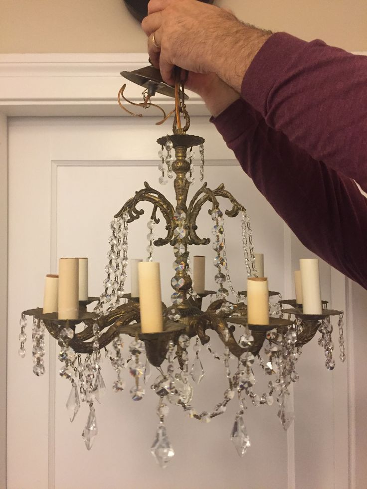 Solid brass and crystal 10 arm chandelier. Needed a good