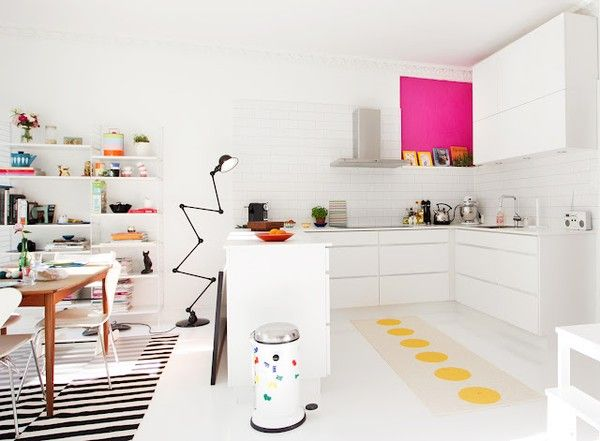 love this kitchen/dining room. Love the rug under the table and the plastic matting over the top where the child eats.