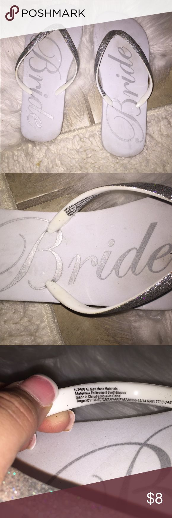 Bride white silver glitter flip flop sz S 5/6 Bride white silver glitter flip flop. Women's sz S (5/6). Only worn once, but as everyone knows white flip flops are very hard to keep clean. Reflects in price, offers accepted! Purchased from Target. Gillagan O' Malley bridal collection. Fast shipping! Gilligan & O'Malley Shoes Sandals