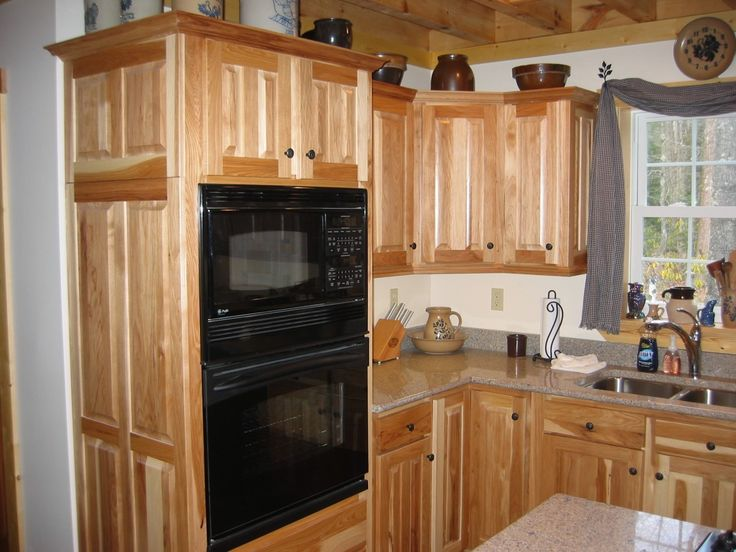 Big microwave toaster in black wooden kitchen cabinet large cupboards granite…
