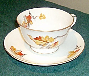 """""""Golden Autumn"""" by Craftsman  tea cup and saucer in a simple china pattern but lovely colors for fall.  I especially like the design being on the inside of the teacup as well as the front & back of it."""