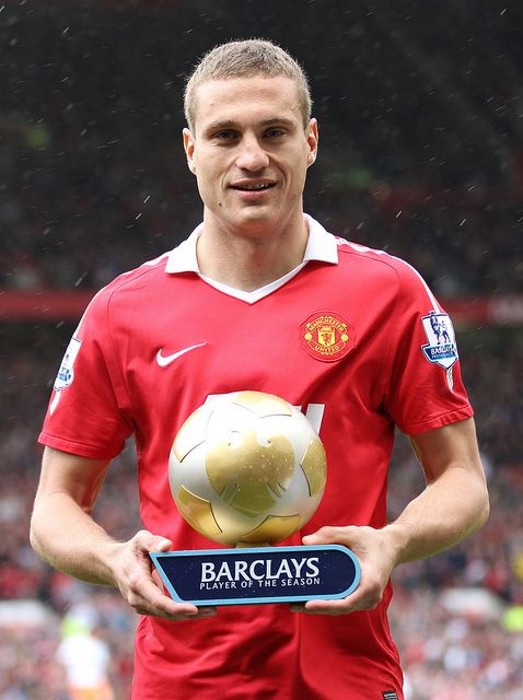 Manchester United's Nemanja Vidic poses with the Barclays Player of the Season Award for 2010/11
