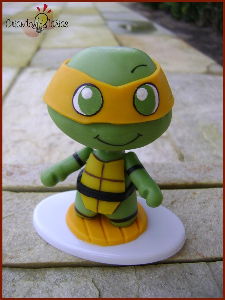 Kawabanga! Michelangelo from The Teenage Mutant Ninja Turtles made in cold porcelain (based on the work of Evilsherbear on Deviantart - http://evilsherbear.deviantart.com/art/Mini-Munny-Mikey-108882130?q=1&qo=1 )
