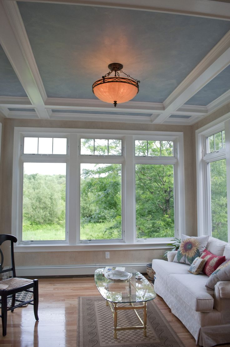 Coffered ceilings with faux painted inset panels.